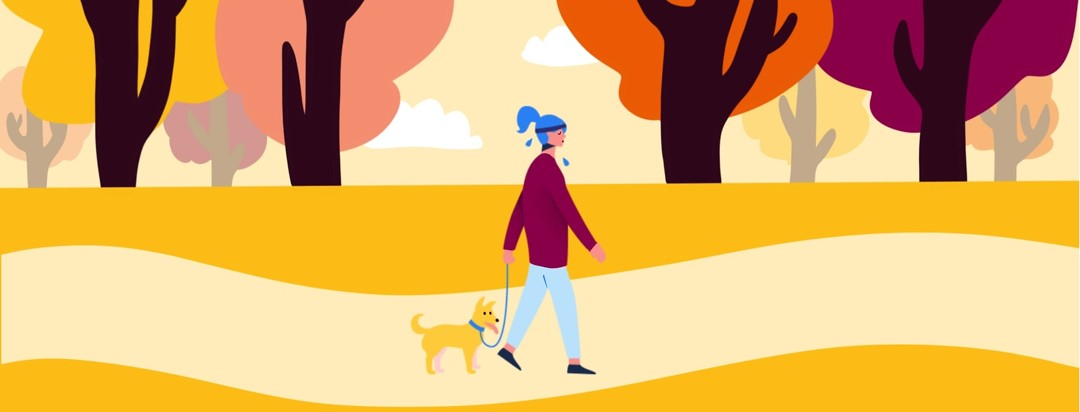 a woman walking a dog for exercise