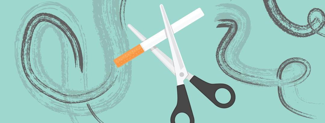 Scissors cutting a cigarette