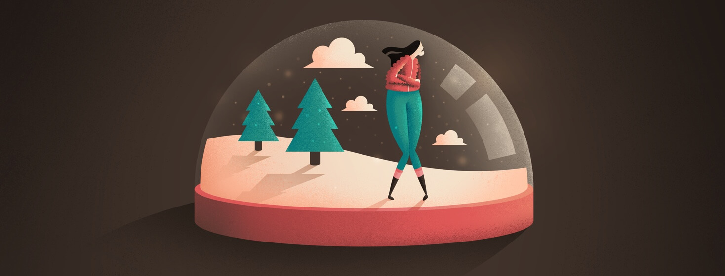 Woman looking sad trapped in a winter snow globe
