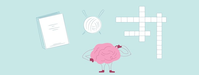 Brain looking up at a book, a ball of yarn, and a cross word puzzle