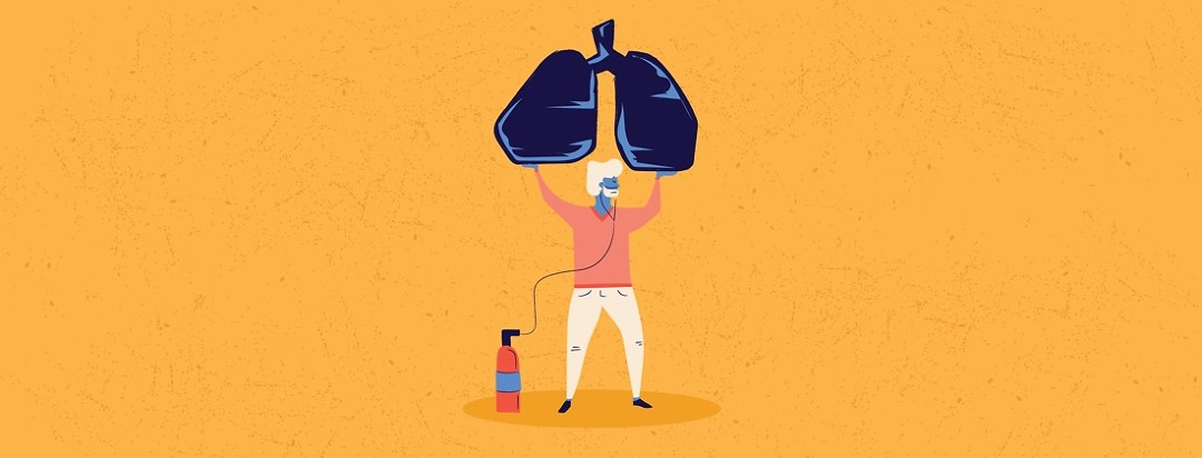 a man with his oxygen tank holding up a pair of lungs
