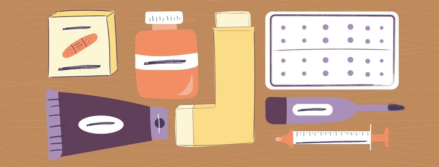 Medications including a pill bottle, an inhaler, bandaids, and a thermometer arranged on a table