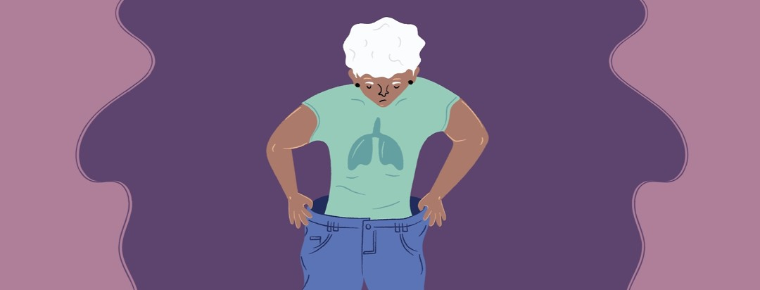 A woman holding the waist of baggy pants with lungs on her shirt