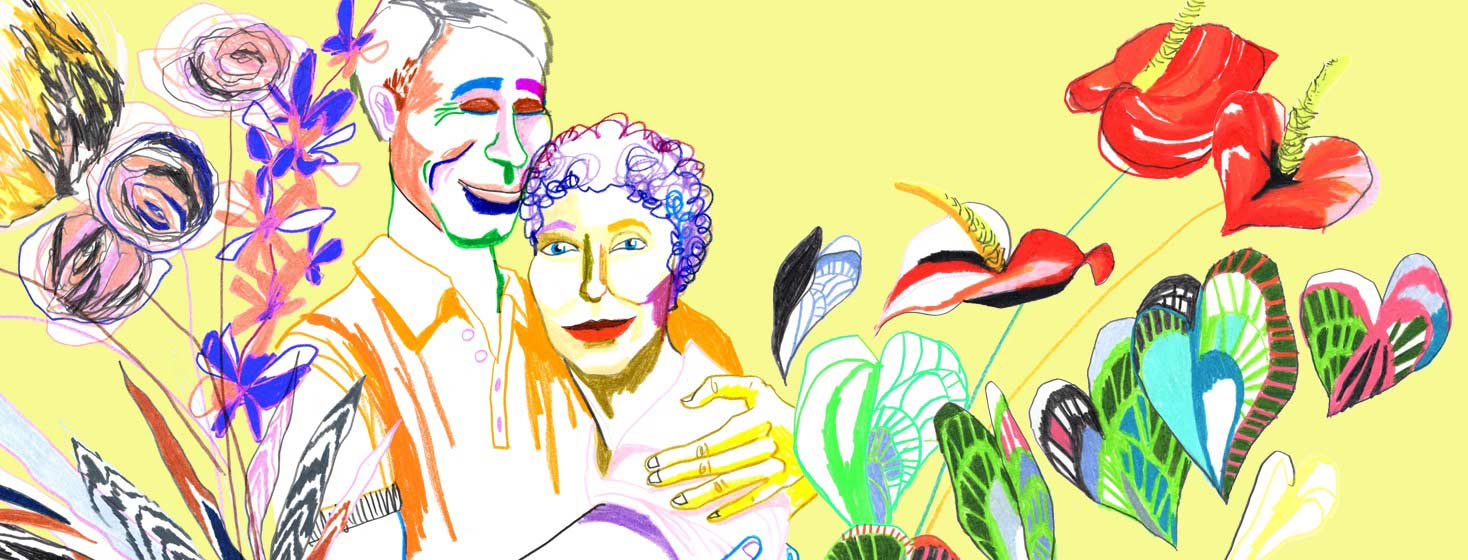 a couple lovingly embraces with abstract colorful flower bouquets surround them