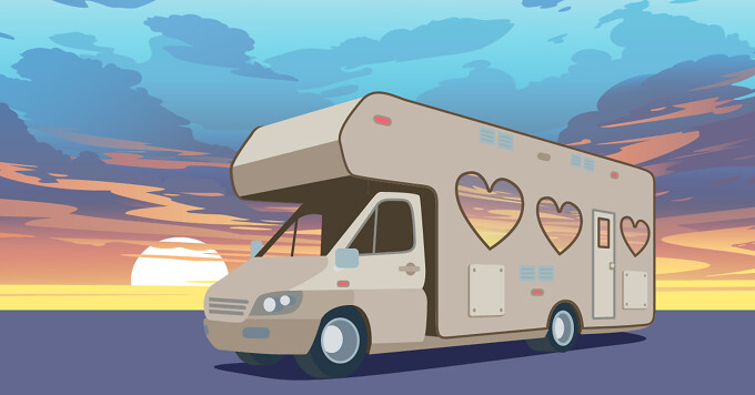 an RV camper with heart-shaped windows, is parked in front of a sunset.