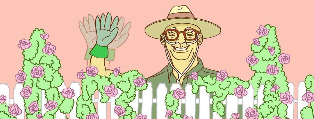 an older man with oxygen cannula is waving from behind a picket fence, covered in roses