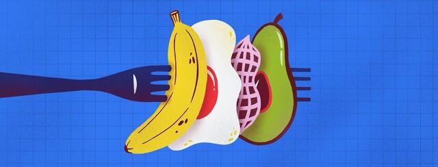 Banana, egg, peanut, and avocado on a fork