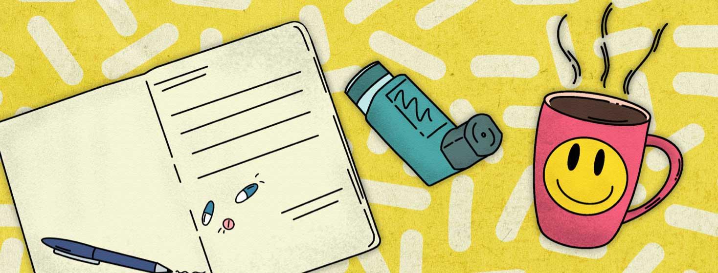Journal with pill doodles, smiley face mug, and inhaler.